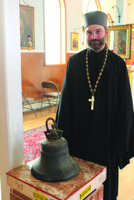 Fr. Innocent Dresdow with repatriated bell [N. Klauss photo].