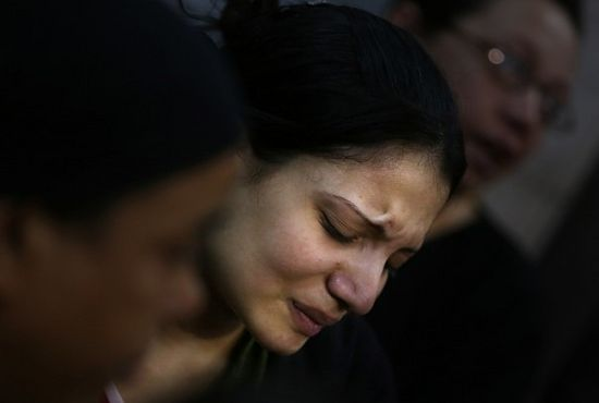 An Egyptian woman mourns during the funeral of several Copt Christians who were killed in Warraq's Virgin Mary church in Cairo, Egypt, Monday, Oct. 21, 2013. AP Photo/Khalil Hamra