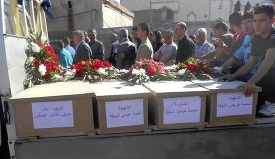 Останки убитых боевиками сирийцев. Садад, Сирия