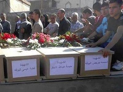Массовые захоронения обнаружены в освобожденной христианской деревне в Сирии