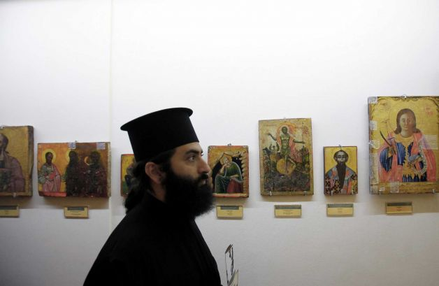 A Christian Orthodox priest looks at returned looted icons at the Byzantine Museum in capital Nicosia, Cyprus, Tuesday, Nov. 12, 2013. Photo: Petros Karadjias, AP / AP