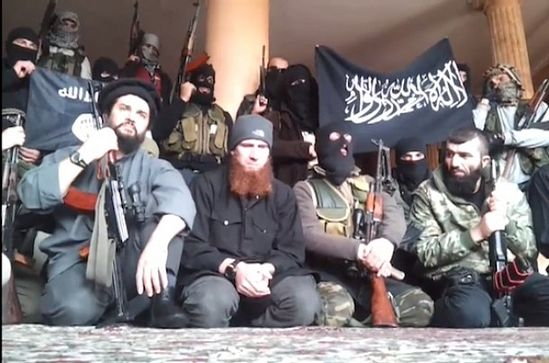 """Чеченские и дагестанские боевики в Сирии. В центре, с рыжей бородой - главарь """"Чеченской бригады"""", Абу Умар Шишани"""