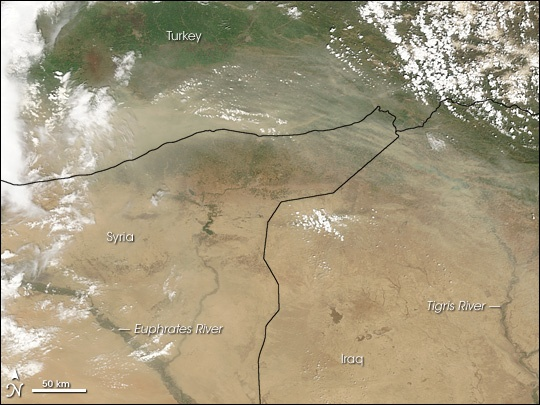 In this 2010 NASA satellite image, vast dust storms can be seen dispersing the light soils of Syria. (NASA)