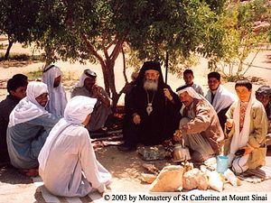 Vladyka Damian conversing with Bedouins