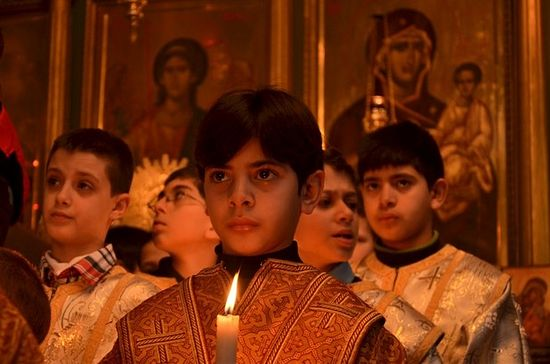 Children participate in Christmas services at the Church of Saint Porphyrius in Gaza City