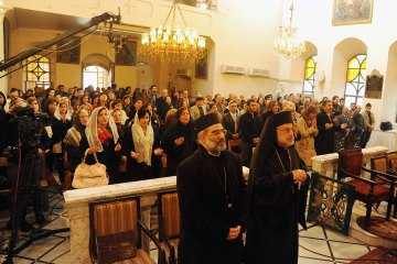 Armenian Orthodox Christians gather at their church of St Sarkis in Old Damascus for Christmas service, January 6, 2014.