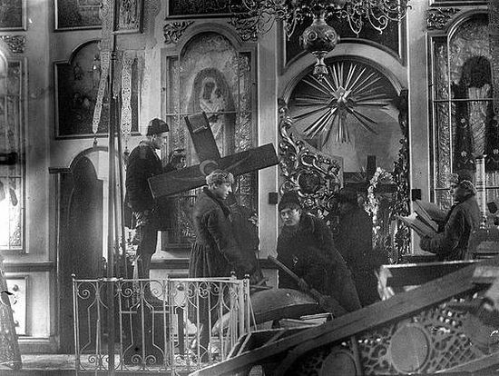 Bolsheviks robbing and defiling the churches.