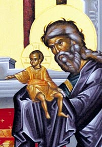 Simeon took Jesus in his arms and praised God.