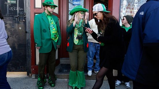Spectators in costume watch the annual South Boston St. Patrick's Day parade in Boston, Massachusetts March 16, 2014.(Reuters / Dominick Reuter)