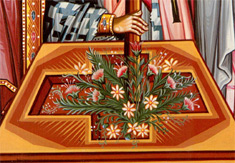 2. At the foot of the cross are flowers.