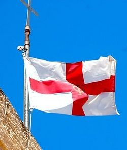 The St George's flag flies above a Palestinian church