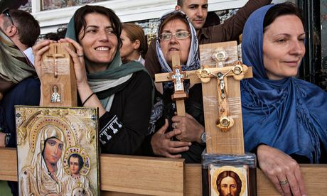Pilgrims wait with crosses near the third Station of the Cross on the Via Dolorosa in Jerusalem's Old City on Good Friday 2014. Photograph: Peter Beaumont
