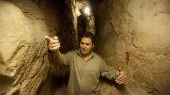Eli Shukron, an archeologist formerly with Israel's Antiquities Authority, walks in the City of David archaeological site near Jerusalem's Old City. The dig, which began in 1995, uncovered a massive fortification and pottery shards that date to 3,800 years ago. Shukron says this is the legendary citadel captured by King David in his conquest of Jerusalem. But archaeologists are divided on identifying Davidic sites in Jerusalem, the city he is said to have made his capital. (AP Photo/Sebastian Scheiner)