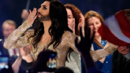 Conchita Wurst, representing Austria, reacts after qualifying in May 2014's Eurovision contest in Copenhagen.