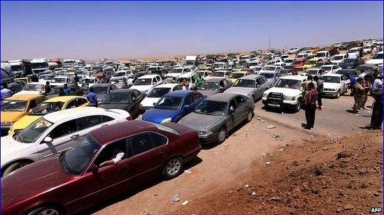 Машины с беженцами скопились у КПП в 40 км от Арбила