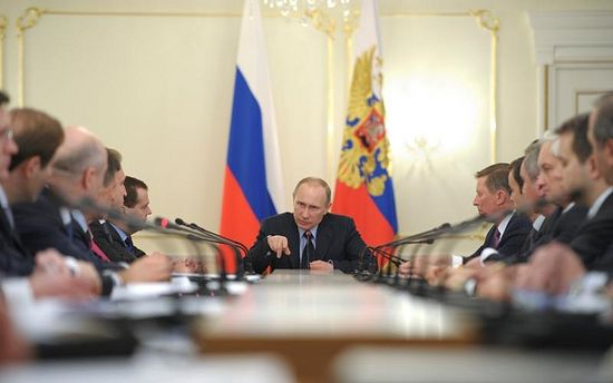 Man with a mission: Putin chairs a meeting at his residence, March 2014. (RIA Novosti / Courtesy Reuters)