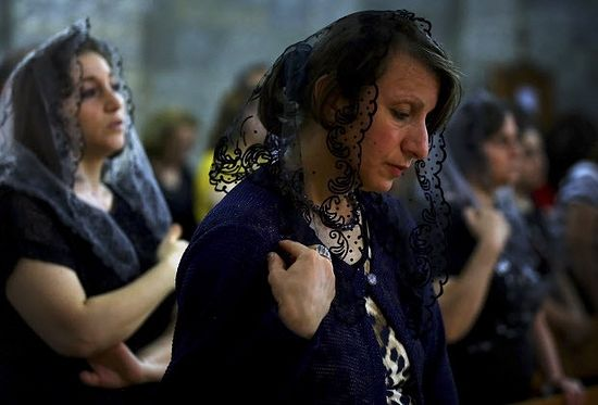 Iraqis attend Mass at the Chaldean Church of the Virgin Mary of the Harvest, in Alqosh, set in the seventh century Saint Hormoz monastery built into a hill overlooking Alqosh, a village of some 6,000 inhabitants about 50 kilometers (31 miles) north of Mosul, northern Iraq. (AP Photo)