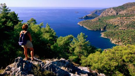A hiker climbs the coastline between Kayakoy and Oludeniz. (John Elk III/Getty)