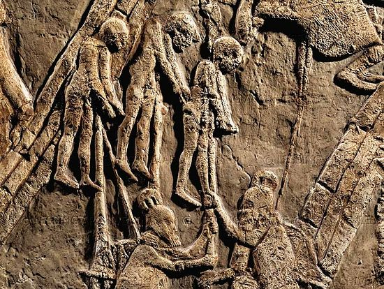 Assyrians placing Israelite captives on spikes. Bas-relief from Nineveh. British Museum.