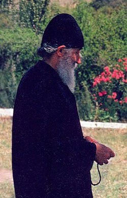 Elder Paisios walking in a garden