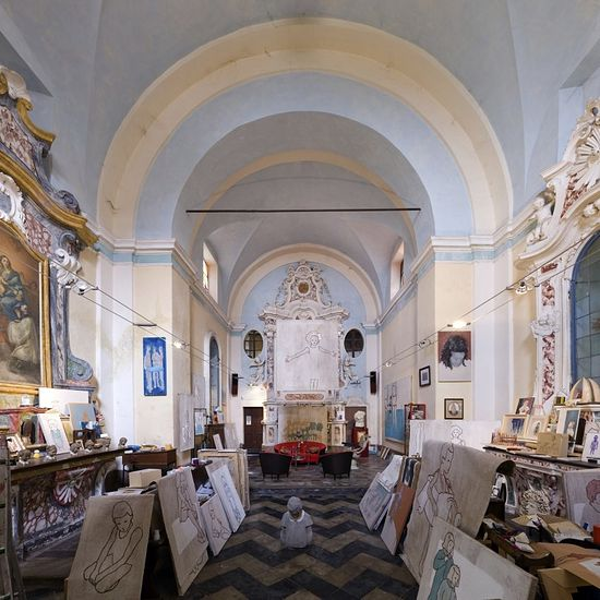 No, these are not images of saints depicted on the pictures. The former San Rocco Church in Verduno now belongs to artist Valerio Berruti who transformed it into his studio and home.