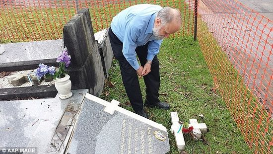 John Koudrin (pictured) stands beside the grave of his former Russian language teacher Anatole Zakroczymski, which was destroyed at Rookwood Cemetery in Sydney