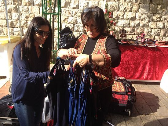 Maisoon Zoabi choosinghand-embroidered tanktops. (photo credit: Jessica Steinberg/Times of Israel)