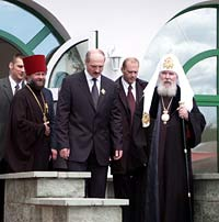 His Holiness Patriarch Alexy, President of Belorussia Alexander Lukashenko, and Fr. Feodor on the porch of the house of Mercy