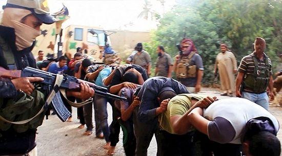 Islamic State militants leading away captured Iraqi soldiers in Tikrit, Iraq.