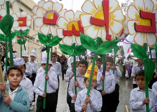 Iraqi Assyrian children parade as they celebrate their New Year in the northern city of Dohuk, 3 April, 2007.