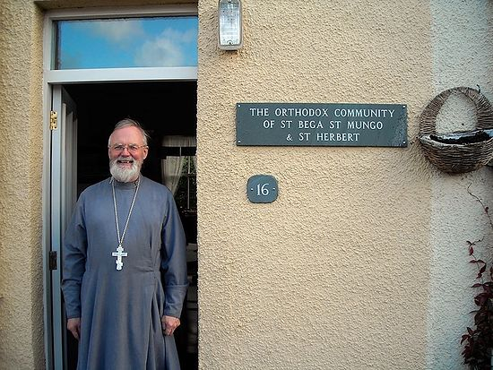 Fr. John Musther at the door of his house in Keswick