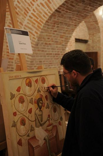 Ioan Popa working on his icon of the Brancovan martyrs (shown below)