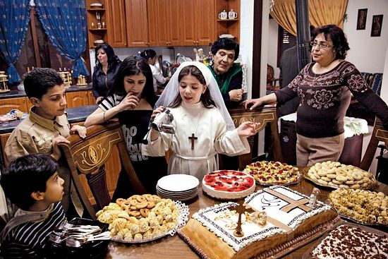 An Orthodox Christian family enjoys an abundance of food for their Easter lunch in the Jaramana district of southern Damascus, Syria on April 19, 2009. ED KASHI/VII