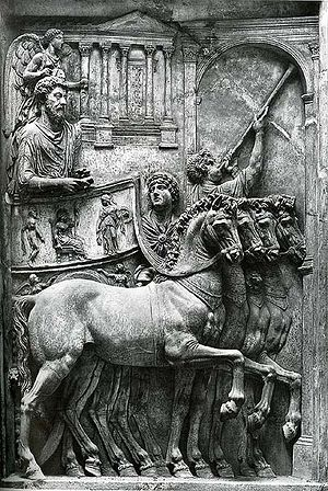 Marcus Aurelius shown in a four horse chariot.