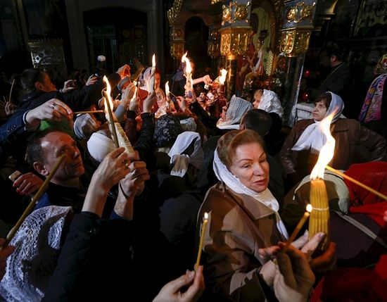 Reuters / Believers light candles during the Holy Fire ceremony on the eve of Orthodox Easter service at the Volodymysky Cathedral in Kiev, Ukraine.