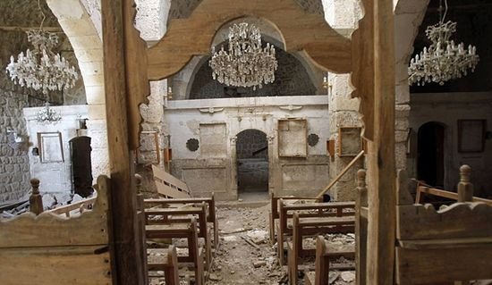 Debris is seen inside a badly damaged church in the Monastery of Mar Sarkis in the ancient Christian town of Maaloula, Syria. File photo