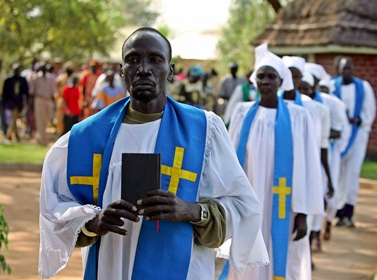 Catholic priests and nuns arrive for a religious ceremony for late John Garang in New Site village in Southern Sudan August 2, 2005. [Southern Sudanese grieved their former leader John Garang around a simple bed on Tuesday and hoped the peace deal he struck would stick under his successor despite rioting over his death that killed 24 people.]