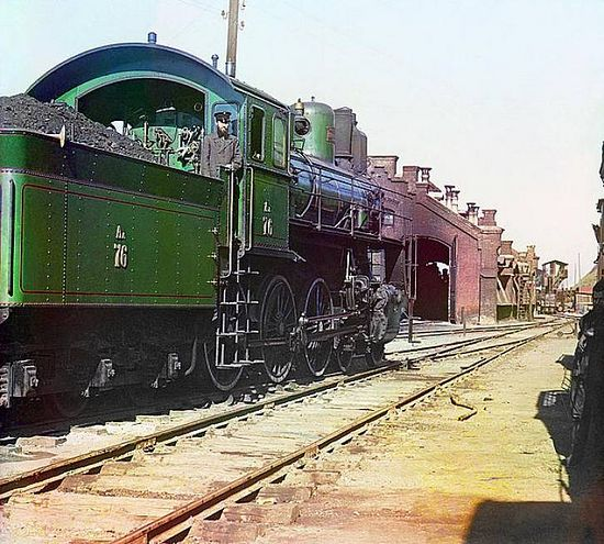Locomotive and coal car at a railroad yard - between 1909-1915