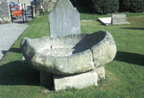 Ancient font in the churchyard of St. Maelruain's Church in Tallaght