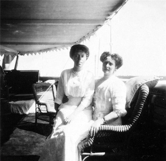 Grand Duchess Olga Alexandrova seated with the Emphress Alexandra