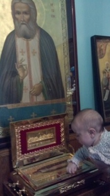 Baby Serafina meets her patron saint at St. Tkhon's Monastery for the first time