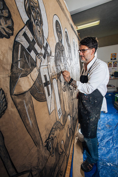 Using charcoal, artist Daniel Balter sketches saints in his studio at Whiteaker's St. John the Wonderworker Orthodox Church.