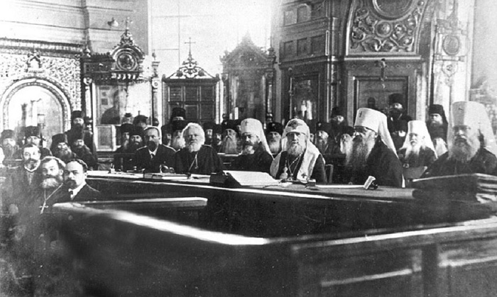 """Newly elected Patriarch Tikhon presides at the """"All-Russian"""" Church Council in Moscow, 1917. Tikhon openly condemned the killings of the tsar's family in 1918, and protested against violent attacks by the Bolsheviks on the Church. Patriarch Tikhon was canonized a saint by the Synod of Bishop of the Russian Orthodox Church Outside of Russia on November 1, (O.S. October 19), 1981. He was later glorified by the Moscow Patriarchate during the Bishop's Council of October 9-11, 1989."""