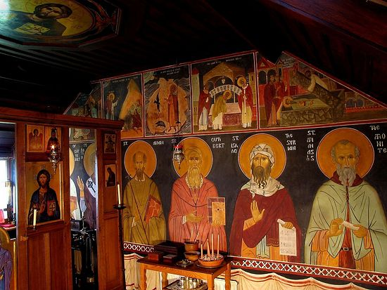 The frescoed chapel of the Monastery of St Anthony and St Cuthbert, U.K., illustrating the quietening effect of a blue/black background.