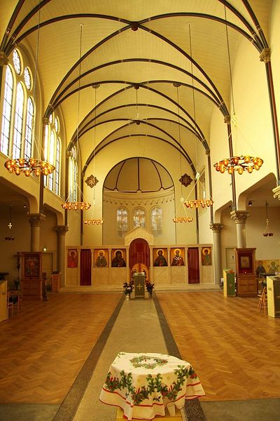 St Nicholas Russian Orthodox Church, Amsterdam, showing how chandeliers can be used to lower the ceiling and so create a more intimate space in an otherwise tall building.