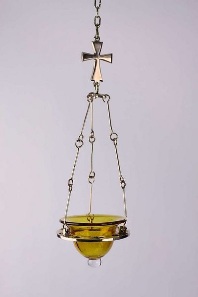 Contemporary brass oil lamp for private chapel, USA, made by the author, with hand blown tinted glass bowl. Design inspired by the illustrated Byzantine bronze lamp.