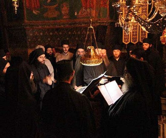 Athonite choir lamp, giving only downward and not broad, ambient light.