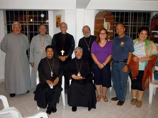 Fr. Serafin and Archbishop Alejo, seated, with 2015 mission team.