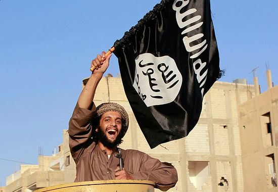 The youth have gone mad over the caliphate. Photo: a fighter with an ISIS flag.