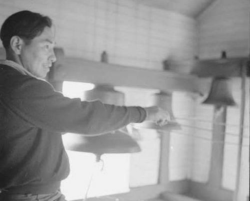 Aleut bell ringer at Belkofski's Holy Resurrection Church, 1938/ Credit: Alaska State Library, Historical Collections, Evelyn Butler and George Dale, Photographs, 1932–1982; George Allan Dale, ASL-P306-0021.
